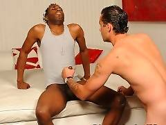 Black dude plays his erect dick. White guy decides to give him good handjob.