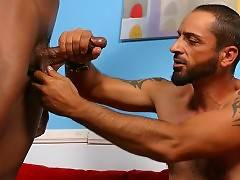 Mature bear with nice beard is asked for help by his black friend. He gives him hand in jerking cock.